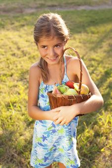 Free Little Girl With Basket Of Fresh Fruit Royalty Free Stock Image - 34633466