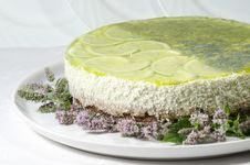 Lime Cheesecake Decorated With Mint Flowers Royalty Free Stock Photography