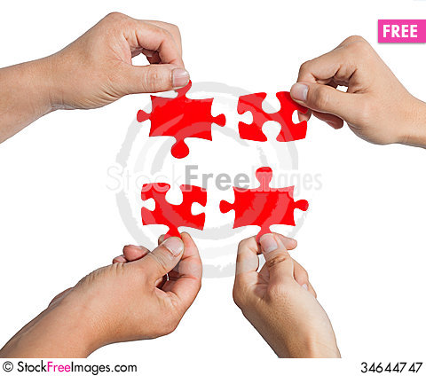 Free Hands And Puzzle Royalty Free Stock Photography - 34644747