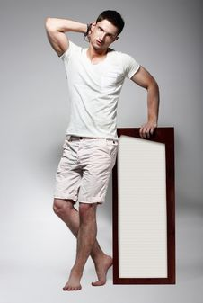 Free Elegant Young Man In White Cotton Clothes With Board Standing Stock Photography - 34655842