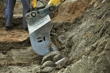 Free Excavator Pours Stones Stock Photo - 34656240