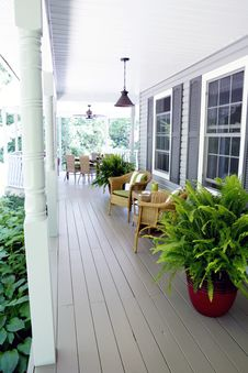 Free Outdoor Living Under A Covered Porch Stock Photos - 34658313