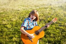 Boy Playing The Guitar Stock Image