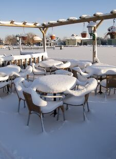 Snow Covered Furniture In The Winter Stock Photos