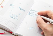 Free Human Hand Sketching Multiple Ideas On A Organizer Stock Photos - 34678593