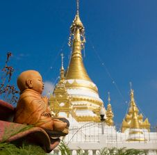 Free Baby Buddha Statue Against The Stupa Stock Image - 34692631