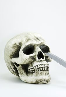 Free Skull With A Knife Blade Stock Photo - 3470380
