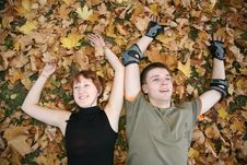 Free Young  Couple Lies In Leaves Stock Photo - 3472630