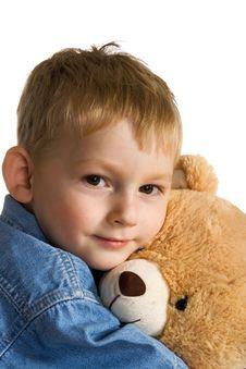 Little Boy Embraces A Teddy Stock Photo