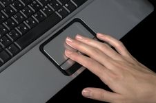 Free Hand Over Laptop On Black Stock Image - 3475511