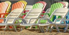 Rows Of Colored Beach Chairs Stock Image