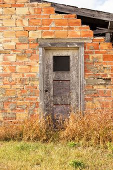 Free A Partial Brick Wall With A Grey Door Stock Images - 34710744