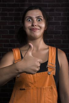 Free Pretty Girl With Funny Facial Expression Showing Thumbs Up Sign Stock Image - 34752351