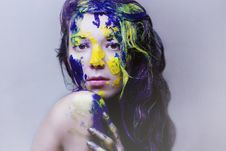 Beauty Portrait Of Girl Painted Blue And Yellow