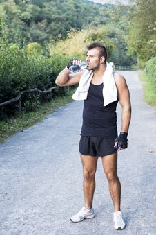 Free Athletic Man With Water Bottle After His Exercising Outdoor. Stock Photo - 34772610
