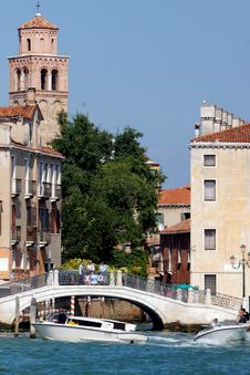 Picturesque Venetian Canals With Motor Boats And Bridge In Venic Royalty Free Stock Photos