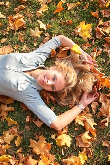 Blonde In Autumn Leaves Royalty Free Stock Image