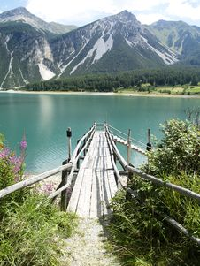 Wooden Jetty In Mountains Royalty Free Stock Photos