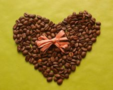 Coffee Beans In A Shape Of Heart With A Bow Royalty Free Stock Images
