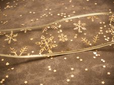 Golden Snowflake Ribbon On Golden Background Stock Images