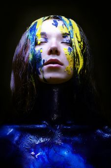 Free Girl Painted Blue And Yellow On Black Background Stock Photo - 34814890