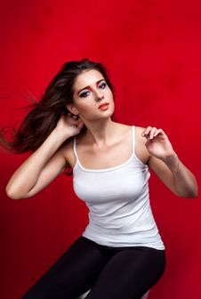 Free Girl With Flying Hair On Red Background Stock Photography - 34815452