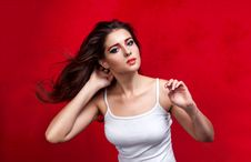 Free Girl With Flying Hair On Red Background Stock Images - 34815884