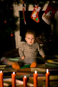 Free Baby Sitting On Floor Near Fireplace Royalty Free Stock Images - 34821629