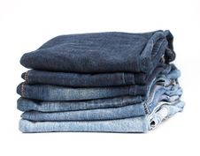 Free Stack Of Jeans On White Background Stock Photography - 34826912