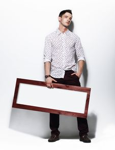 Free Fashion Man Holding Board With White Blank Space For Text Stock Image - 34832451
