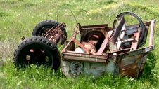 Free Old Machinery In The Grass Stock Photos - 34879503