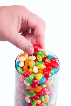 Free Hand Picking Up Jelly Bean Royalty Free Stock Image - 3490576