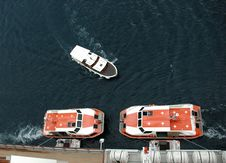 Free Tenders Docked To A Cruiser Stock Photo - 3499750