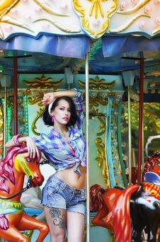 Merry-go-round. Playful Stylish Showy Woman In Roundabout. Funfair Stock Photography