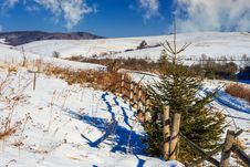 Free Fence By The Road To Snowy Forest In The Mountains Royalty Free Stock Images - 34902089