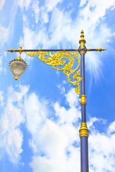 Golden Lighting Pole On Blue Sky
