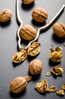 Walnuts And Nutcracker Royalty Free Stock Photos