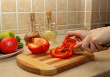 Cutting Red Pepper On A Cutting Board Royalty Free Stock Photos