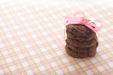 Chocolate Cookies And Pink Ribbon Royalty Free Stock Photo