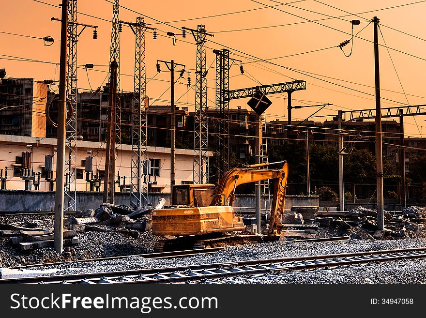 Railway construction site in sunset