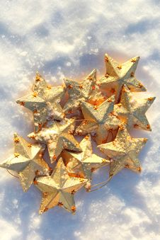 Free Golden Stars In The Snow Stock Photos - 34957493