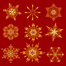 Free Golden Snowflakes On A Red Background Stock Photo - 34961490