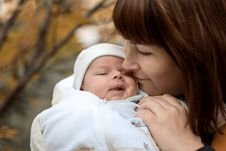 Newborn On The Mother S Hands In The Park In Autumn Royalty Free Stock Photography