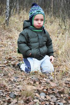 Free In The Forest Sitting On The Grass Sad Upset Boy Royalty Free Stock Photo - 34974095