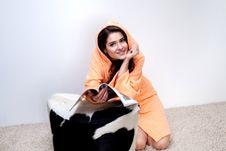 Free Girl In Orange Bathrobe Reading Magazine At Home Stock Images - 34975524