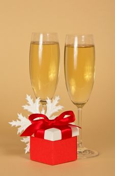 Free Wine Glasses With Champagne, A Red Gift Box Royalty Free Stock Image - 34977986