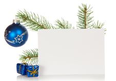 Fir-tree Branch With A Christmas Toy And Card Stock Photo
