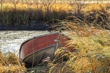 Free A Red Canoe Docked In Tall Grass Stock Image - 34992161