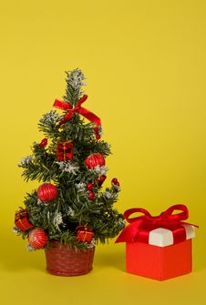 Free Small Fir-tree In A Pot With Toys And Gifts Stock Photos - 34995423