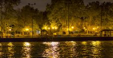Free Sidewalk By Canal, Lit By Several Lamp Posts, And Small Pier Royalty Free Stock Images - 34996289